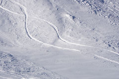 Tracks on a mountain Slope, extreme freeride. In deep snow Stock Image