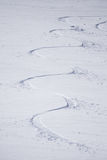 Tracks on a mountain Slope, freeride in deep snow. Tracks on a mountain Slope, extreme freeride in deep snow Royalty Free Stock Image