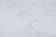 Tracks on a mountain Slope, freeride in deep snow Royalty Free Stock Image