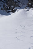 Tracks on a mountain Slope, freeride in deep snow. Tracks on a mountain Slope, extreme freeride in deep snow Stock Image