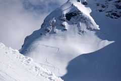 Tracks on a mountain Slope, freeride in deep snow Royalty Free Stock Photos