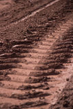 The tracks on the muddy road Stock Photos