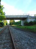 Tracks & Overpass. Old train tracks running under an overpass royalty free stock photos