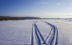 Tracks on the river ice from a snowmobile stock photos