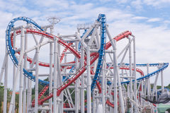 Tracks of Roller coaster against blue sky, Perspective Concept.  Stock Image