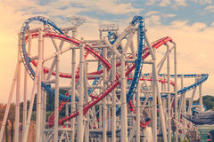 Tracks of Roller coaster against blue sky, Perspective Concept.  Stock Photography