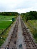 Tracks at rushcliffe country park. Railway tracks cutting through the park near Ruddington,  Nottinghamshire Royalty Free Stock Images