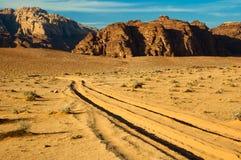 Tracks in sand. Car tracks in desert sand in Wadi Musa, Jordan Stock Photo