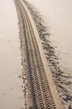 Tracks On Sand. Tyre tracks on the sand of the beach Stock Photography