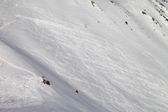 Tracks on ski slope, freeriding. Caucasus Mountains, Georgia, ski resort Gudauri Royalty Free Stock Photo