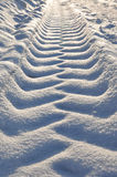 Tracks in the snow. Car tire tread imprint on the snow royalty free stock photo