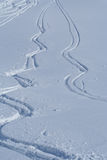 Tracks in the snow. Several sets of tracks mark the otherwise smooth surface of the snow covered ground royalty free stock photography