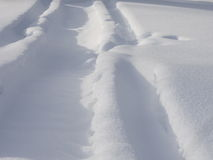 Tracks in snow. Background withtracks in soft Deep snow Royalty Free Stock Images