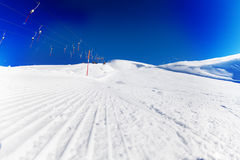 Tracks of snowcat on the packed snow at ski resort Stock Image