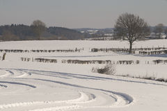Tracks in snowy landscape Royalty Free Stock Photo