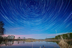 Tracks from stars of above the lake Stock Photos