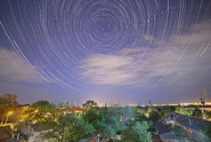 Tracks of stars in night sky. Above city Royalty Free Stock Image