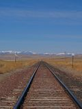 Tracks to the Mountains. This image of the railroad tracks leading to the mountains was taken in west central Montana Stock Photo
