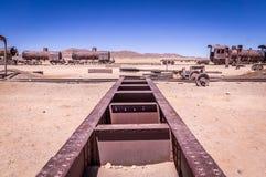 Tracks at train cementary near Uyuni. Train tracks leading nowhere at Uyuni train cementary, Bolivia. Rusty old locomotives in the background Stock Photography