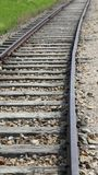 Tracks of a train that curve towards the next station Stock Photo