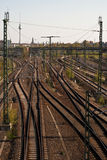 Tracks with TV tower. Many railroad tracks with the television tower in the background Royalty Free Stock Photography