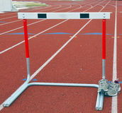 Trackshoes and hurdle Stock Photography