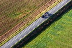 Tracktor в полях Стоковая Фотография