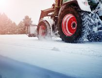 Free Tracktor Cleaning On Winter Road Covered With Snow Royalty Free Stock Image - 159899126