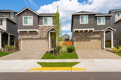 Tract Homes Front in New Subdivision. In North America suburban residential neighborhood royalty free stock photos