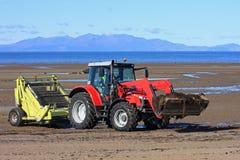 Tracteur de décapant de plage Photo stock