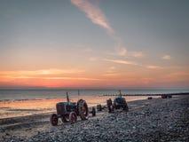 Tracteurs sur la plage de Cromer Image libre de droits