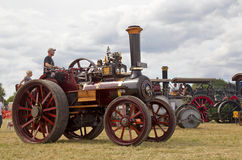 Tractiion engine steam. POTTEN END, UK - JULY 27: A preserved steam traction engine gives a display to the public in the main show arena  at the Dacorum Steam Royalty Free Stock Photo