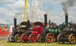 Traction Engines at Pickering annual Rally. Traction Engines at the annual rally held in Pickering from 2nd to 5th August 2012 with fairground big wheel sticking Stock Photos