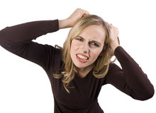 traction frustrante de cheveu de fille image stock