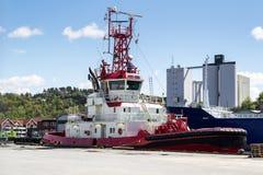 Traction subite de BELOS et bateau pilote Photos libres de droits
