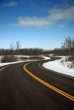 Traction Test. A recently paved divided road twisting through the Canadian countryside Royalty Free Stock Photos