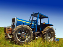 Blue tractor in field Stock Photo