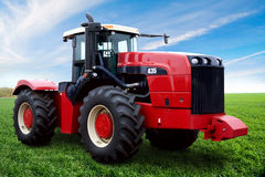 The Tractor. On a green field Royalty Free Stock Photography