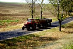 Tractor. On a road and fields Royalty Free Stock Photography