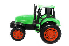 Tractor. Green plastic tractor toy isolated on white Royalty Free Stock Photos
