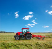 Tractor. Over a green field stock photography