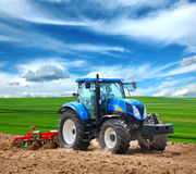 Tractor. Cultivating tractor in the field Royalty Free Stock Photos
