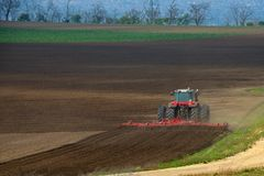 Tractor. Plowing the fields in the countryside Royalty Free Stock Photos