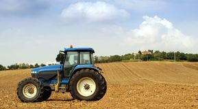 Tractor. In a field in summer Royalty Free Stock Image
