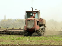 Tractor. Spring plowing on the field Royalty Free Stock Images