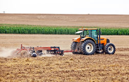 Tractor. Raking a field in preparation for the next crop to be planted Royalty Free Stock Photography