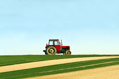Tractor. Plowing the fields horizontal Royalty Free Stock Image