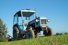 Tractor. An old blue tractor vehicle stock image