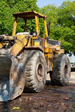 Tractor. A tractor end work on road Royalty Free Stock Photo