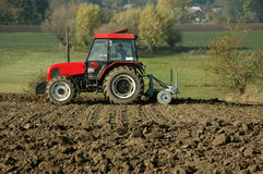 Tractor. At work on a field stock images